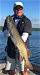 Father & Son Muskie Fishing by Brad